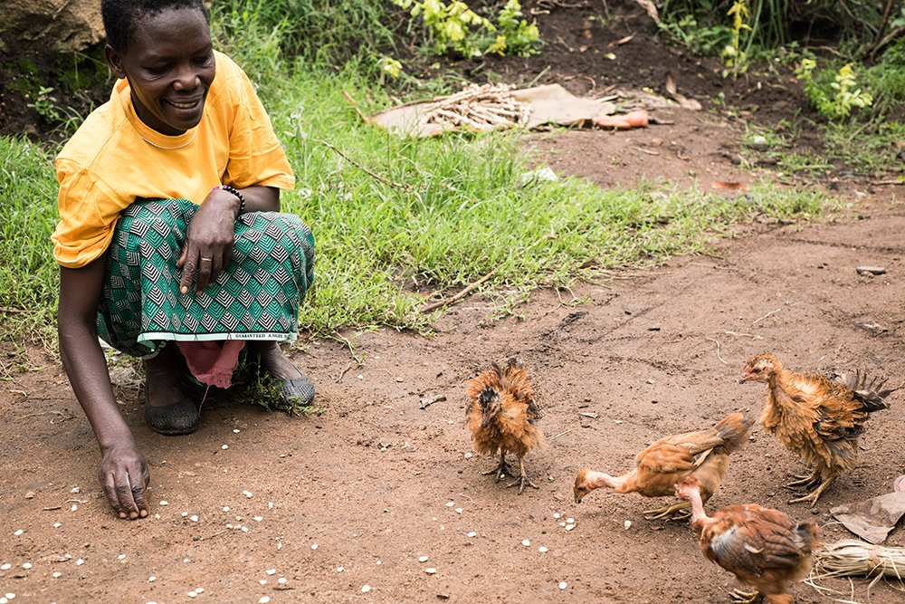 Alice Nasambu with her chickens