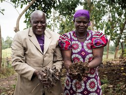 Samuel and Rosemary Wanjala holding handfuls of their soil in Kenya
