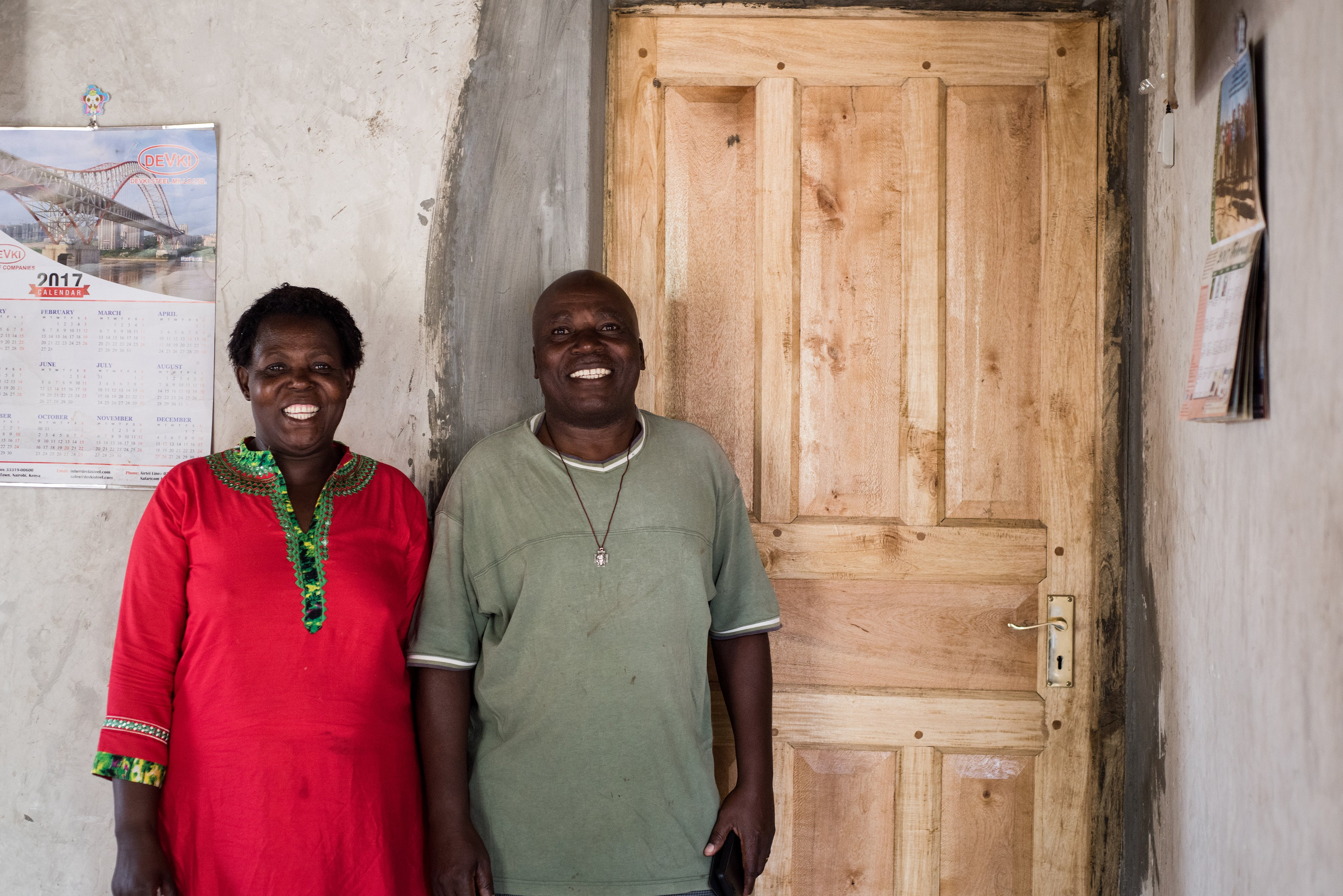 Davis & Emelda Mukolwe with door of grevillea