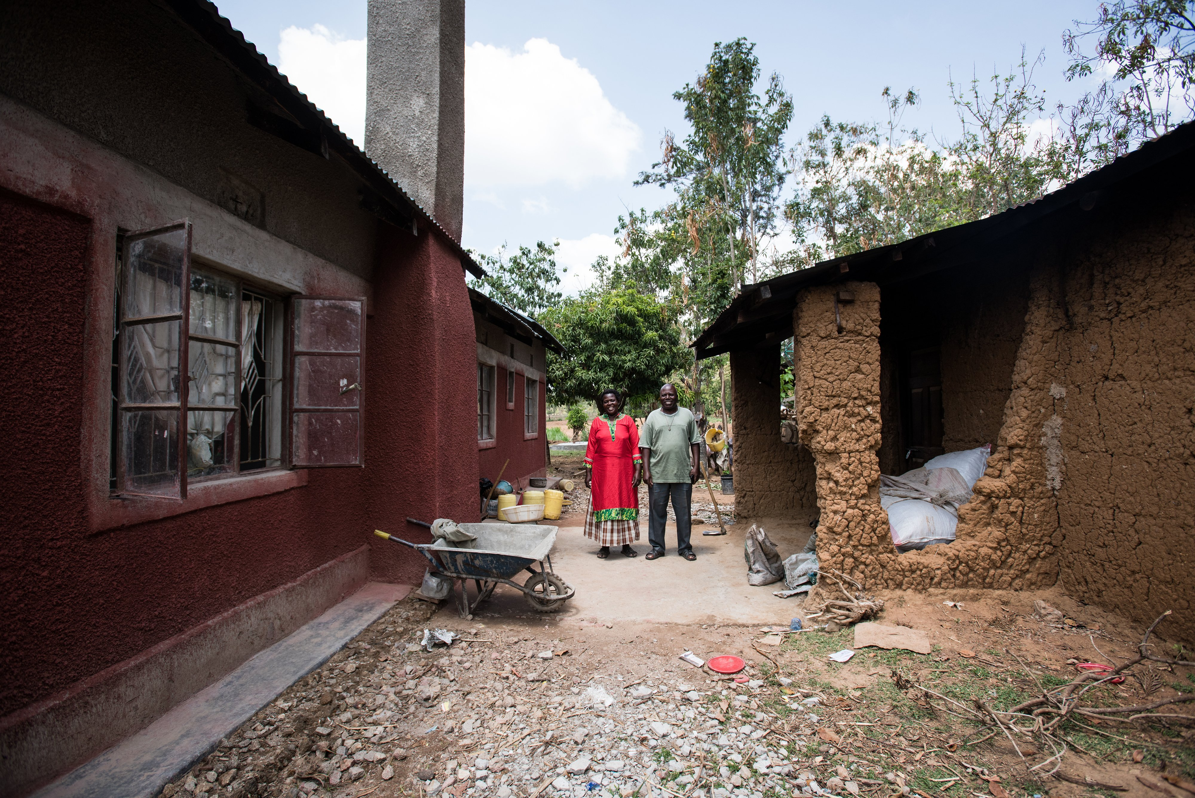 Davis & Emelda Mukolwe outside their home