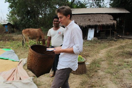Louis Terren with a farmer in Myanmar