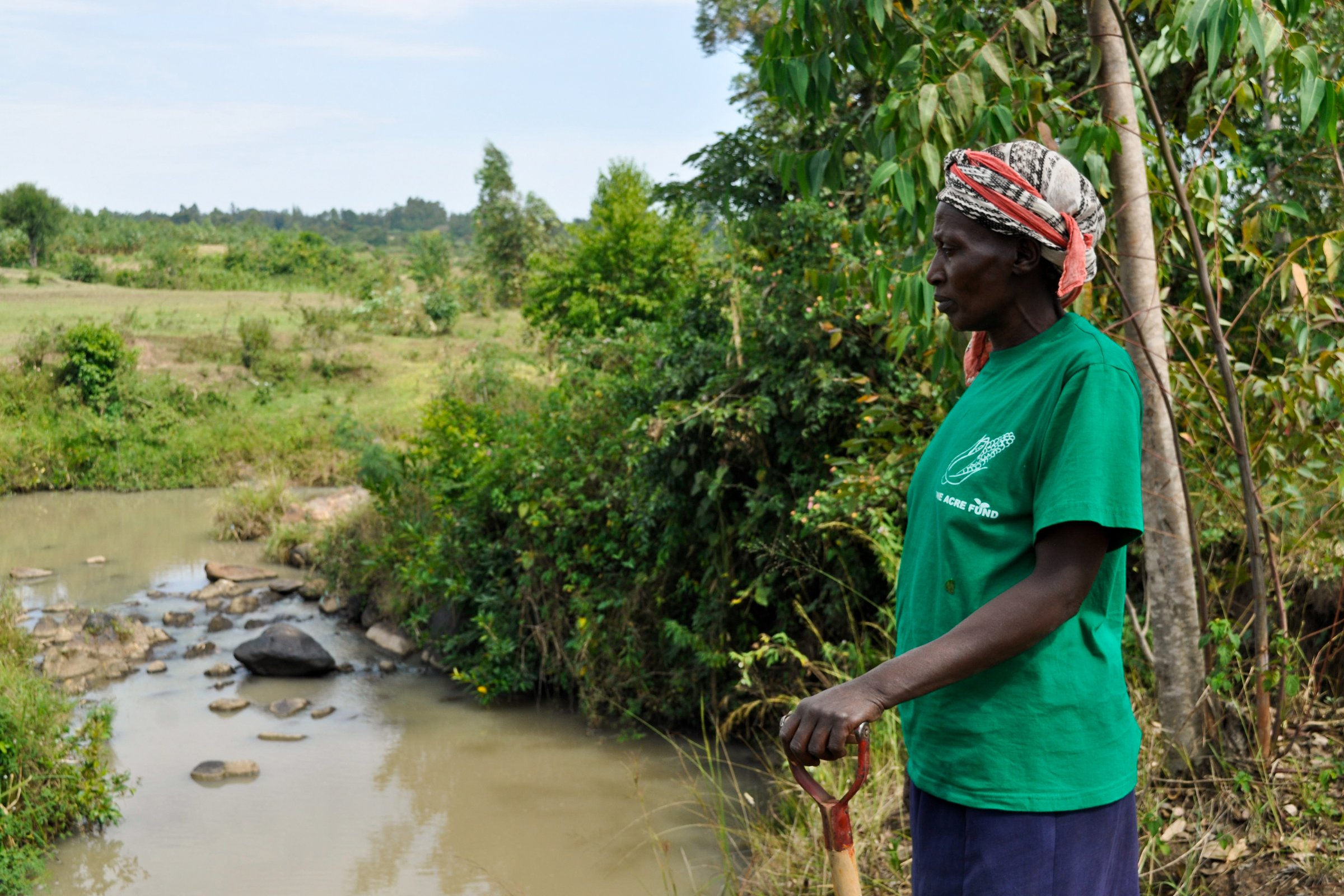 Mary Nekesa Stands Aside a River