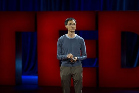 Andrew Youn onstage at TED