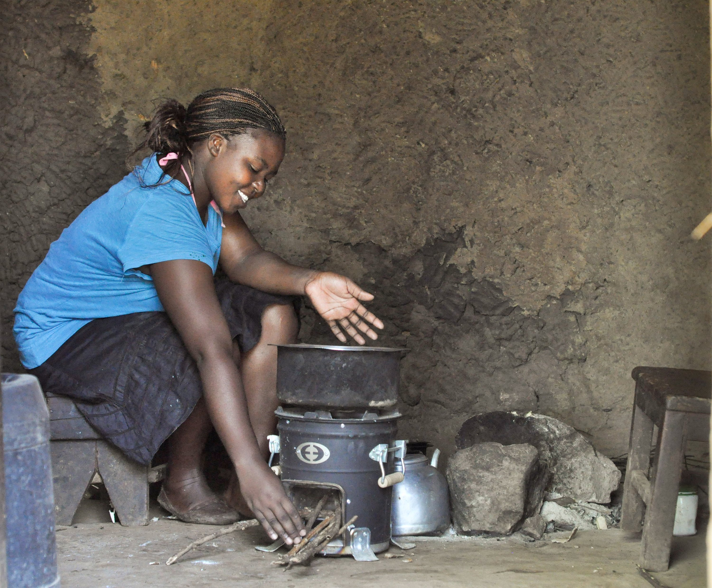 Violet Nalinya prepares food with her cookstove in Kenya
