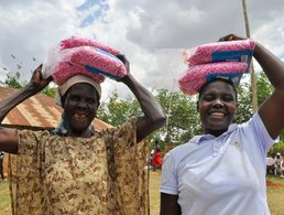 Two farmers holding hybrid maize seed