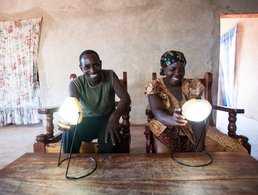 Jimmy and Suzana Nziku with solar lights